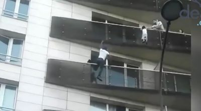 "Real-Life ""Spiderman"" Scales Building to Save a Child"